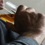elderly-man-addicted-to-alcohol-surrounded-by-empty-bottles-drinks